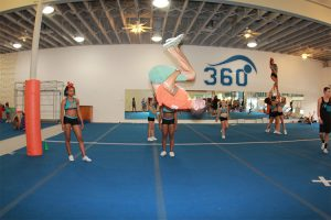 heer-couch-doing-flip-mid-air-during-practice-tuck
