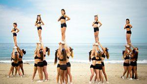 cheerleaders-doing-cheer-stunts-on-the-beach-now-hiring-fb