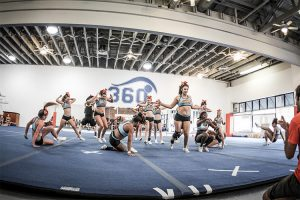 girls-cheerleading-squad-doing-routine-during-practice-cyclone-1